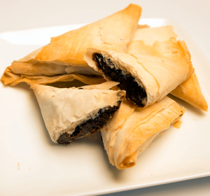 plate with chocolate filled phyllo turnovers