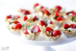 caprese filled phyllo shells on stand